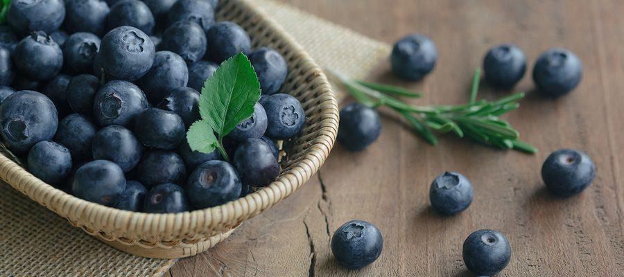Fresh Wild Blueberries In Wood Basket On Sack. Wild Blueberry Pu