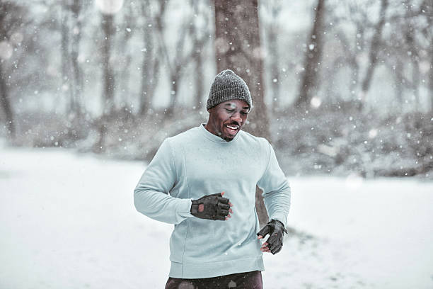 Black man running in snow